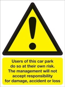 Users Of Car Park Do So At Their Own Risk Management Will Not Accept Responsibility Security Safety Sign - Portrait